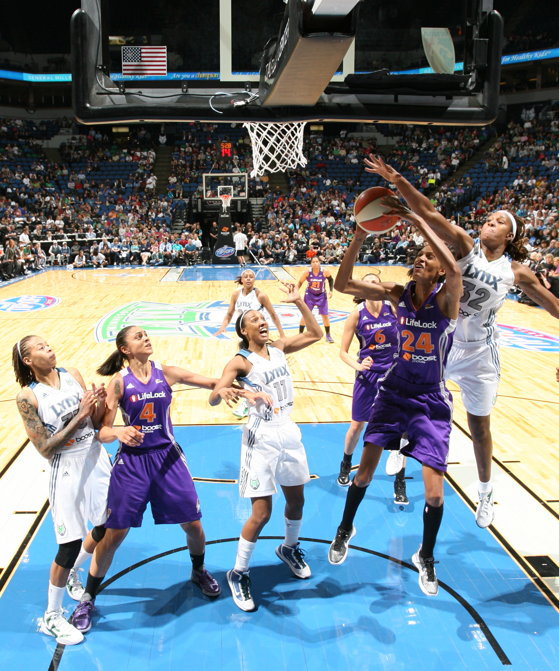 2012's Home-Opener: Lynx forward Rebekkah Brunson blocks one of her three shots on the night to go with her 12 points and nine rebounds.