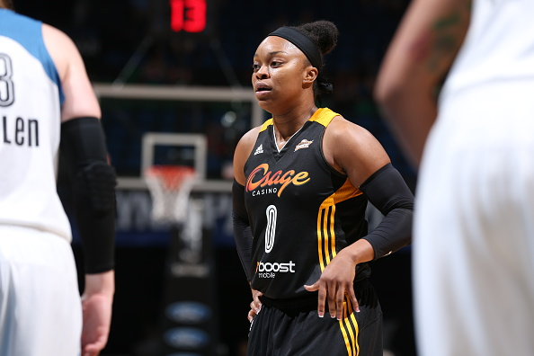 MINNEAPOLIS, MN - JUNE 5:  Odyssey Sims #0 of the Tulsa Shock looks on against the Minnesota Lynx during the season opener of their WNBA game on June 5, 2015 at Target Center in Minneapolis, Minnesota. NOTE TO USER: User expressly acknowledges and agrees that, by downloading and or using this Photograph, user is consenting to the terms and conditions of the Getty Images License Agreement. Mandatory Copyright Notice: Copyright 2015 NBAE (Photo by David Sherman/NBAE via Getty Images)