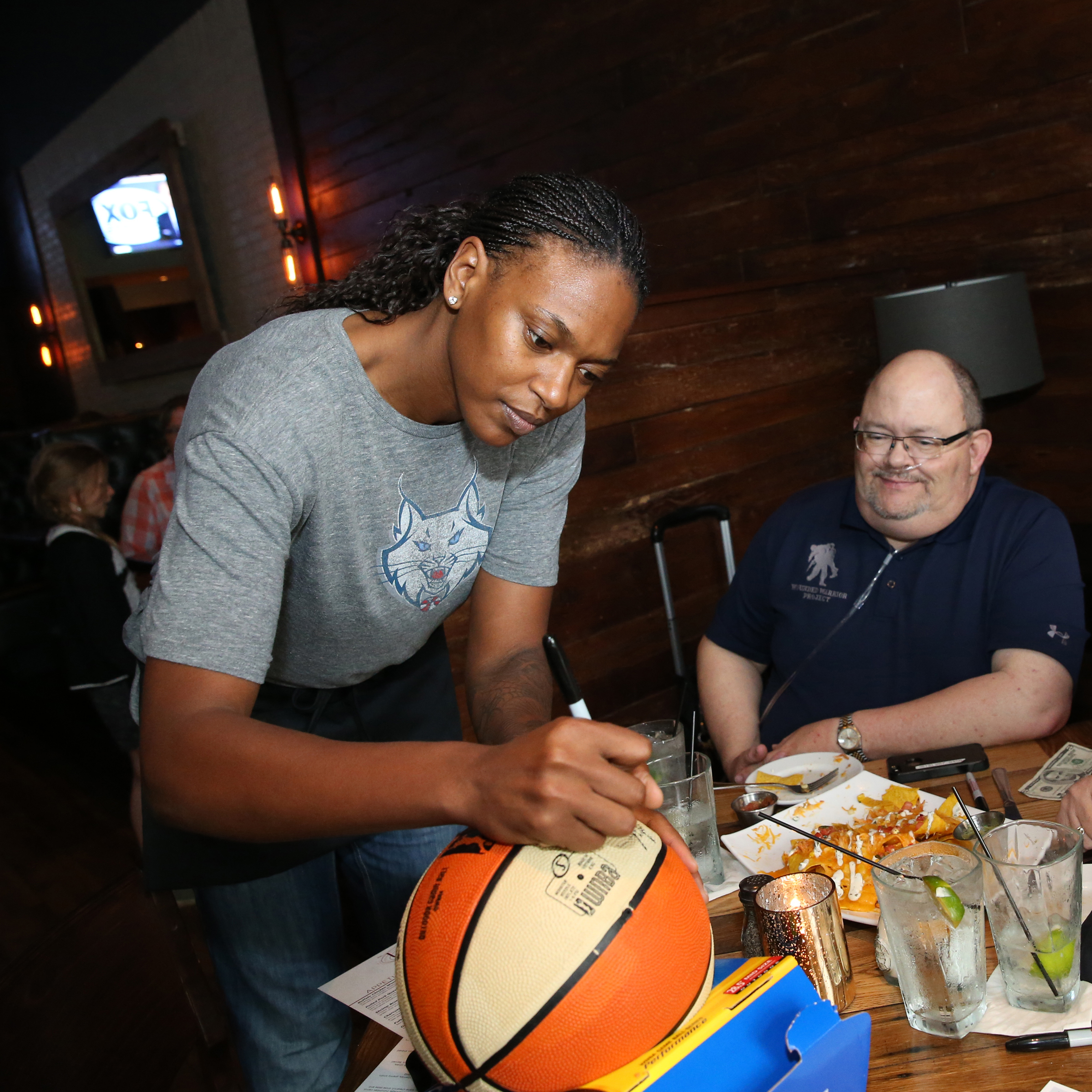 MINNEAPOLIS, MN - JUNE 3:  Asjha Jones #15 of the Minnesota Lynx signs autographs during the Tip-A-Lynx fundraiser to benefit the Minnesota Lynx Fastbreak Foundation on June 3, 2015 at the Loop West End Bar & Restaurant in Minneapolis, Minnesota.  NOTE TO USER: User expressly acknowledges and agrees that, by downloading and or using this Photograph, user is consenting to the terms and conditions of the Getty Images License Agreement. Mandatory Copyright Notice: Copyright 2015 NBAE (Photo by David Sherman/NBAE via Getty Images)