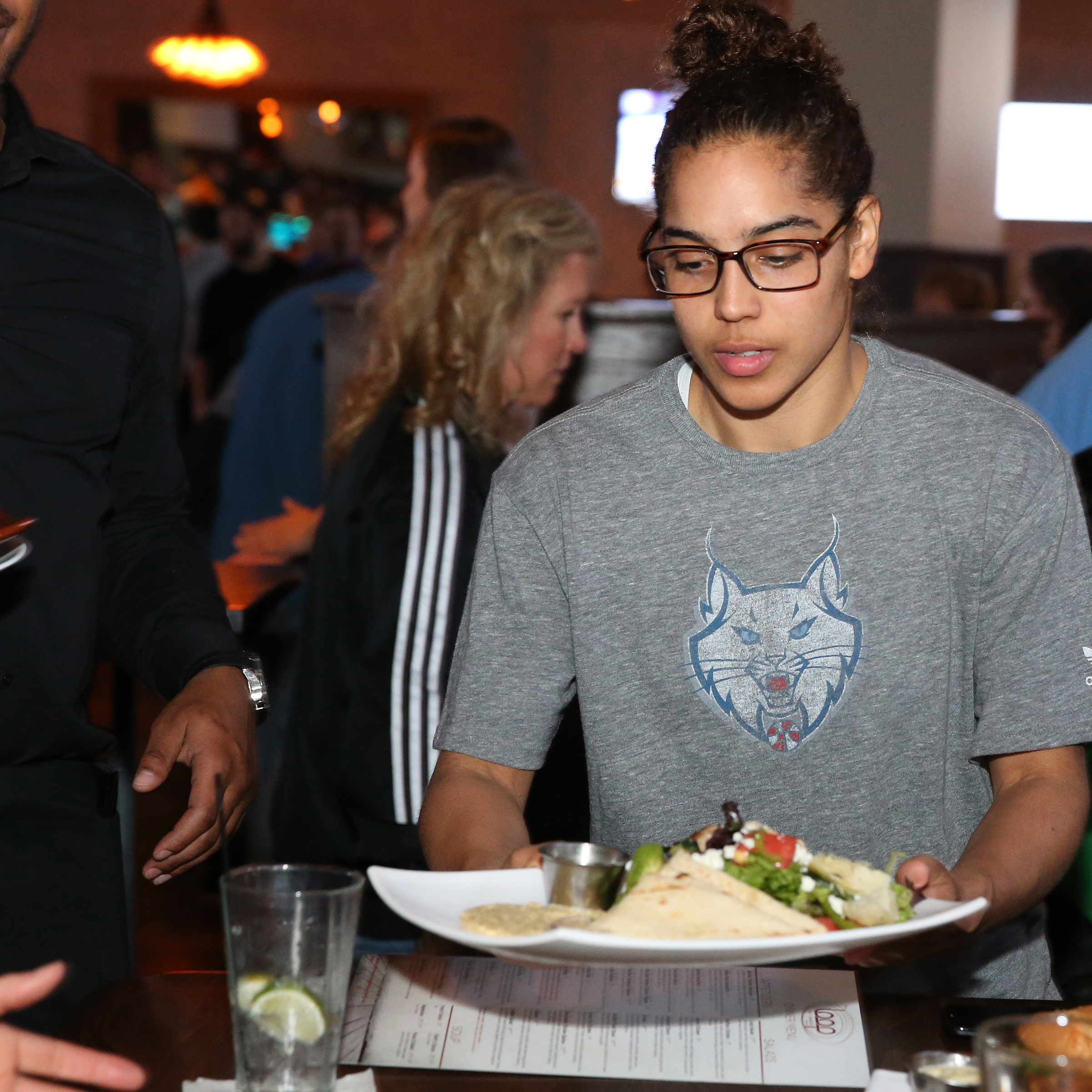 MINNEAPOLIS, MN - JUNE 3:  Jennifer O'Neill #0 of the Minnesota Lynx serves food during the Tip-A-Lynx fundraiser to benefit the Minnesota Lynx Fastbreak Foundation on June 3, 2015 at the Loop West End Bar & Restaurant in Minneapolis, Minnesota.  NOTE TO USER: User expressly acknowledges and agrees that, by downloading and or using this Photograph, user is consenting to the terms and conditions of the Getty Images License Agreement. Mandatory Copyright Notice: Copyright 2015 NBAE (Photo by David Sherman/NBAE via Getty Images)