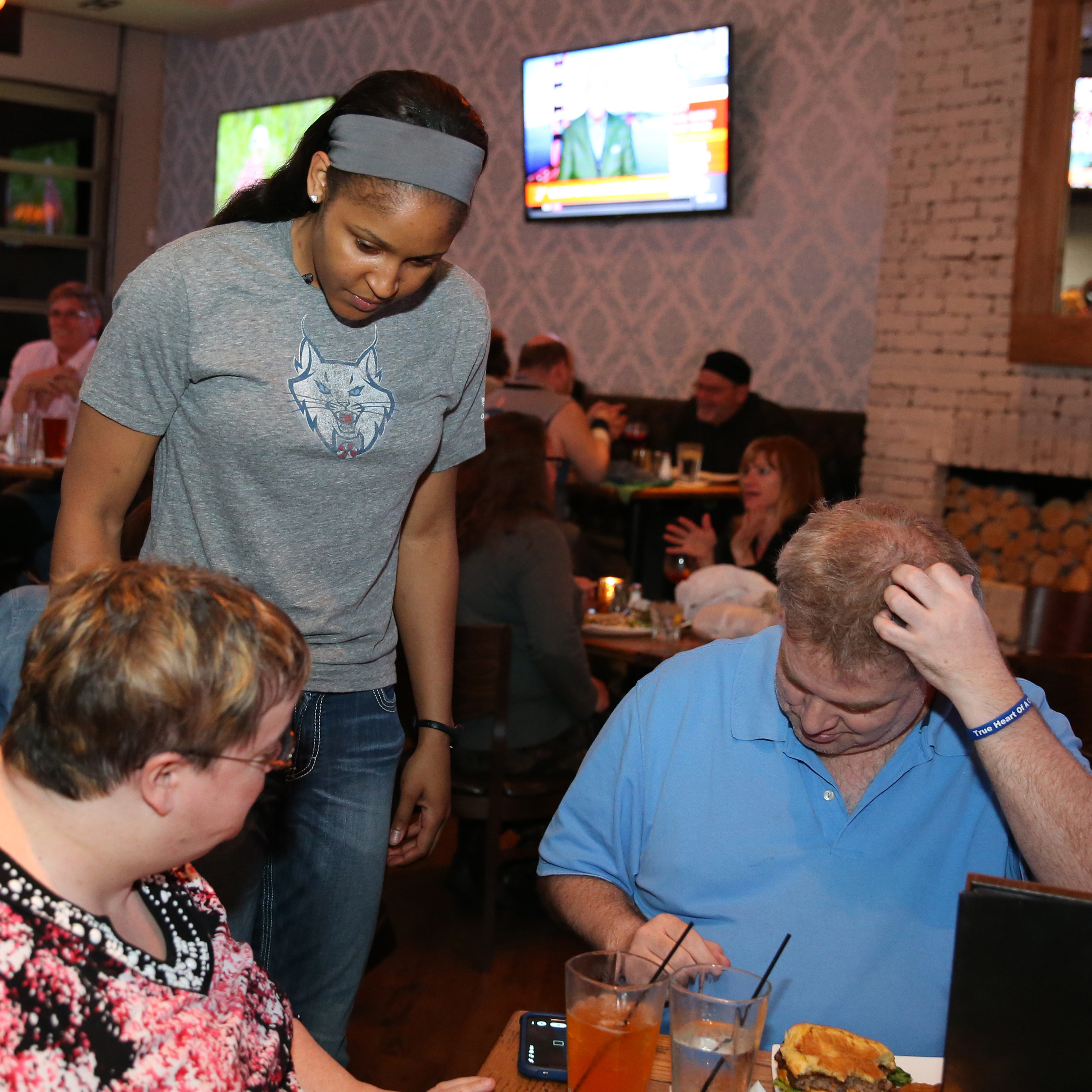 MINNEAPOLIS, MN - JUNE 3:  Maya Moore #23 of the Minnesota Lynx takes orders during the Tip-A-Lynx fundraiser to benefit the Minnesota Lynx Fastbreak Foundation on June 3, 2015 at the Loop West End Bar & Restaurant in Minneapolis, Minnesota.  NOTE TO USER: User expressly acknowledges and agrees that, by downloading and or using this Photograph, user is consenting to the terms and conditions of the Getty Images License Agreement. Mandatory Copyright Notice: Copyright 2015 NBAE (Photo by David Sherman/NBAE via Getty Images)