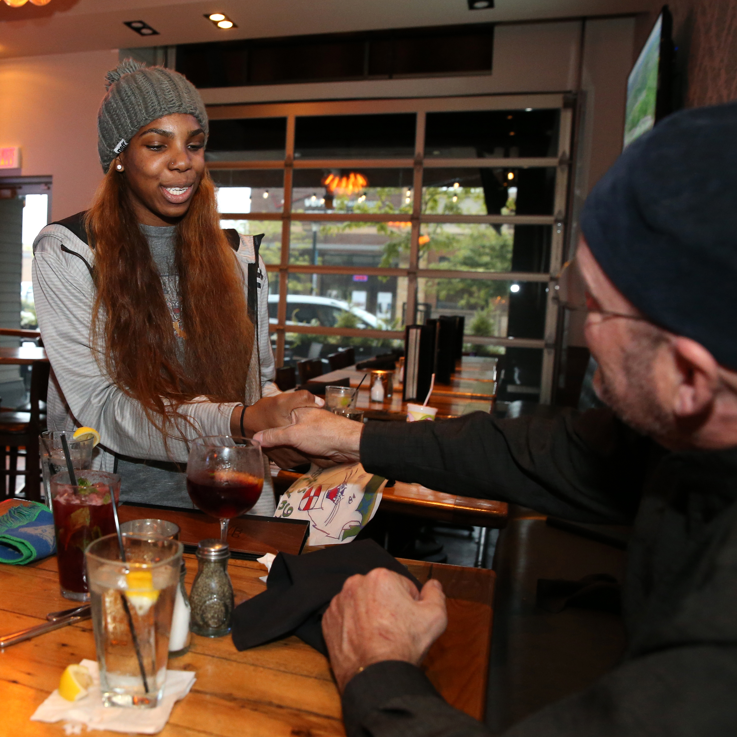 MINNEAPOLIS, MN - JUNE 3:  Reshanda Gray #21 of the Minnesota Lynx greets fans during the Tip-A-Lynx fundraiser to benefit the Minnesota Lynx Fastbreak Foundation on June 3, 2015 at the Loop West End Bar & Restaurant in Minneapolis, Minnesota.  NOTE TO USER: User expressly acknowledges and agrees that, by downloading and or using this Photograph, user is consenting to the terms and conditions of the Getty Images License Agreement. Mandatory Copyright Notice: Copyright 2015 NBAE (Photo by David Sherman/NBAE via Getty Images)