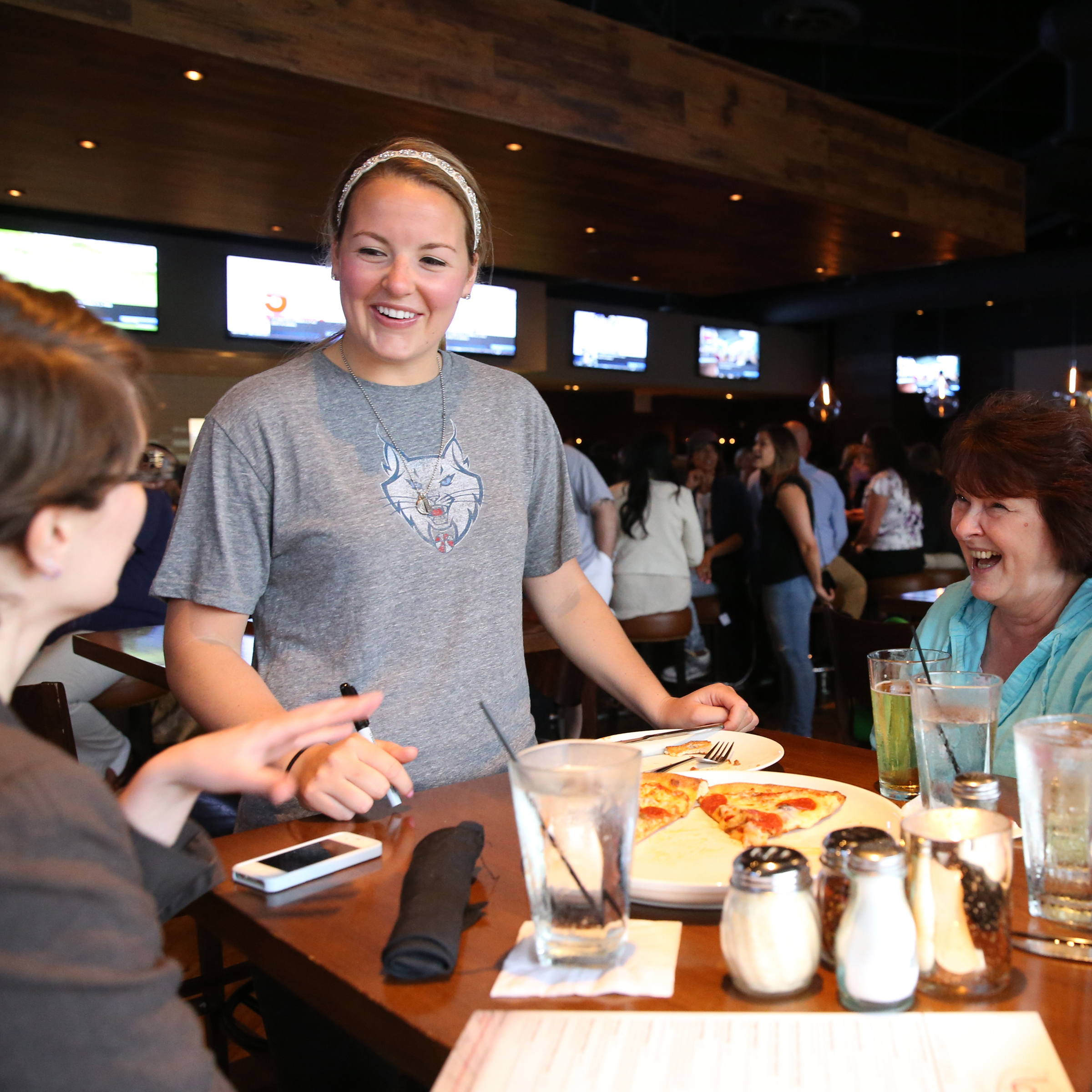 MINNEAPOLIS, MN - JUNE 3:  Tricia Liston #20 of the Minnesota Lynx takes food orders during the Tip-A-Lynx fundraiser to benefit the Minnesota Lynx Fastbreak Foundation on June 3, 2015 at the Loop West End Bar & Restaurant in Minneapolis, Minnesota.  NOTE TO USER: User expressly acknowledges and agrees that, by downloading and or using this Photograph, user is consenting to the terms and conditions of the Getty Images License Agreement. Mandatory Copyright Notice: Copyright 2015 NBAE (Photo by David Sherman/NBAE via Getty Images)