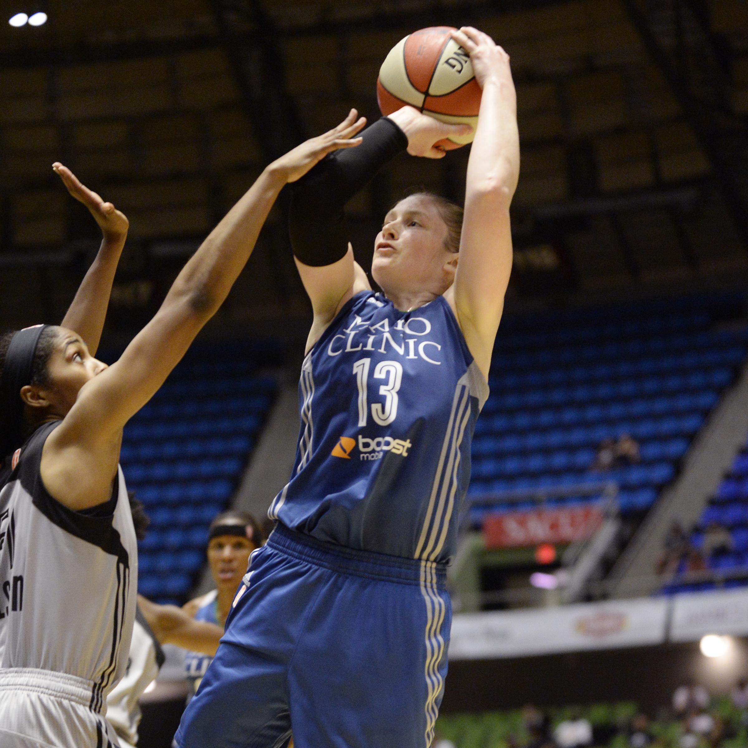 Lynx guard Lindsay Whalen falls away to score two of hersix points. Whalen's six points was her lowest total in a game this season.