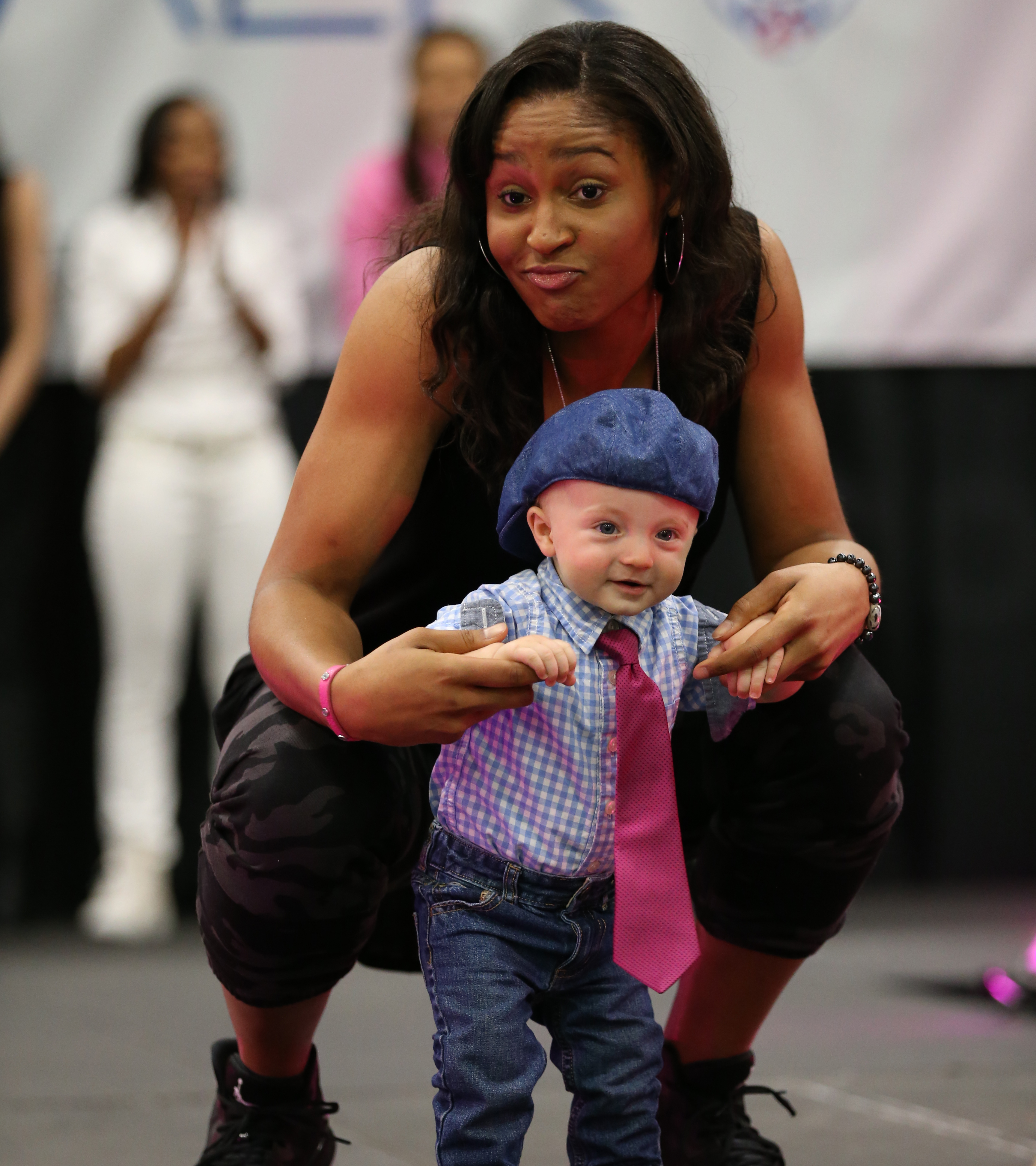 Lynx forward Maya Moore strikes a pose with the newest member of the Lynx team.