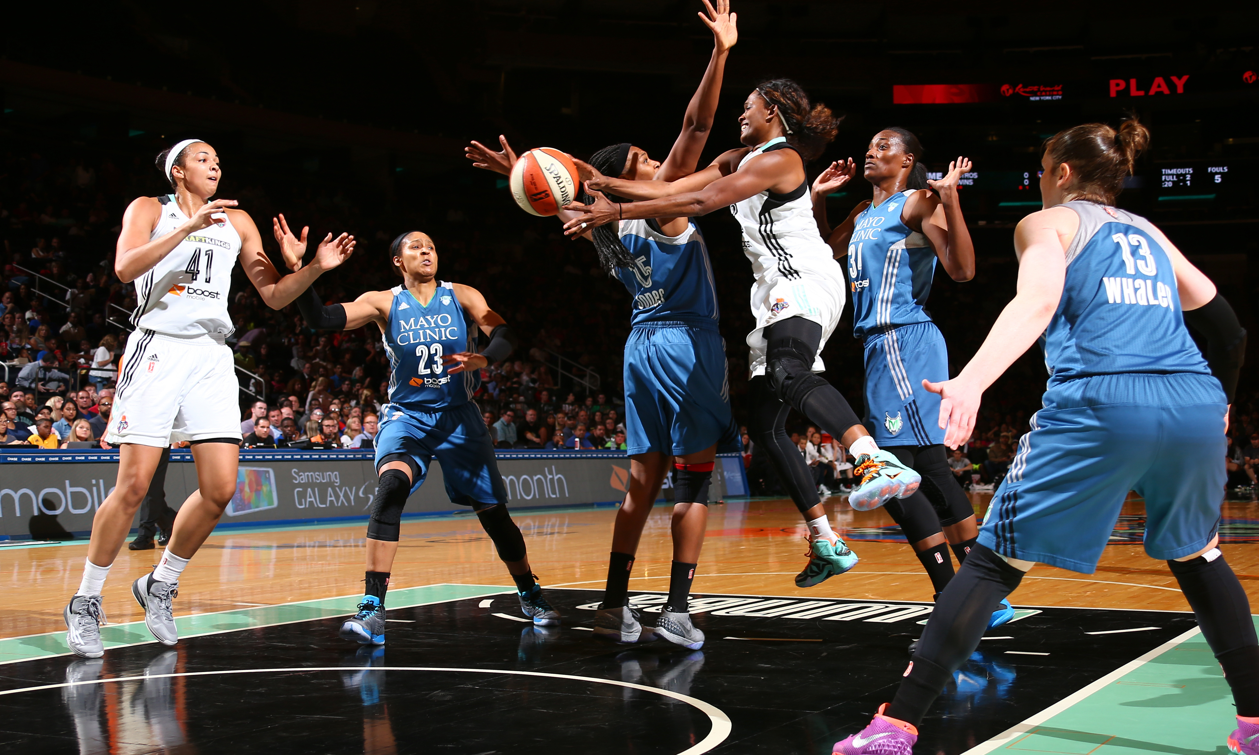 Lynx guard Lindsay Whalen (13) could only watch as her teammates attempted to stop Liberty forward Swin Cash. Cash had a rather quiet night, finishing with just eight points in 24 minutes of play, while Whalen finished with eight points, three rebounds and four assists.