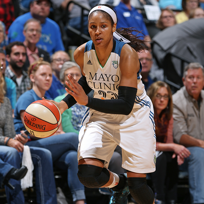 MINNEAPOLIS, MN - SEPTEMBER 24:  Maya Moore #23 of the Minnesota Lynx dribbles the ball against the Phoenix Mercury during Game One of the WNBA Western Conference Finals on September 24, 2015 at Target Center in Minneapolis, Minnesota.  NOTE TO USER: User expressly acknowledges and agrees that, by downloading and or using this Photograph, user is consenting to the terms and conditions of the Getty Images License Agreement. Mandatory Copyright Notice: Copyright 2015 NBAE (Photo by David Sherman/NBAE via Getty Images)