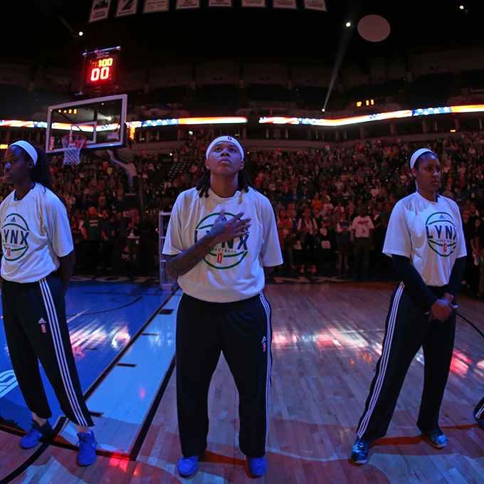 MINNEAPOLIS, MN - SEPTEMBER 22:  Seimone Augustus #33 of the Minnesota Lynx during the national anthem before the game against the Los Angeles Sparks in Game 3 of the 2015 WNBA Western Conference Semifinal on September 22, 2015 at Target Center in Minneapolis, Minnesota.  NOTE TO USER: User expressly acknowledges and agrees that, by downloading and or using this Photograph, user is consenting to the terms and conditions of the Getty Images License Agreement. Mandatory Copyright Notice: Copyright 2015 NBAE (Photo by David Sherman/NBAE via Getty Images)