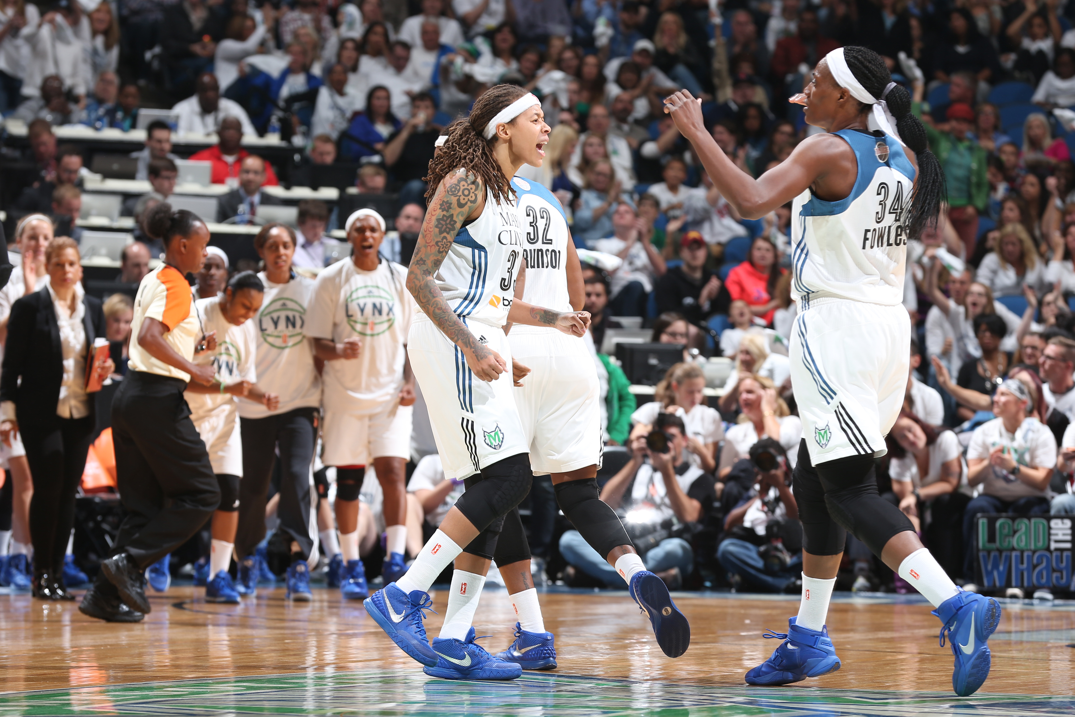 MINNEAPOLIS, MN - OCTOBER 14:  Seimone Augustus #33 of the Minnesota Lynx and Sylvia Fowles #34 of the Minnesota Lynx celebrate during Game Five of the 2015 WNBA Finals against the Indiana Fever on October 14, 2015 at Target Center in Minneapolis, Minnesota.  NOTE TO USER: User expressly acknowledges and agrees that, by downloading and or using this Photograph, user is consenting to the terms and conditions of the Getty Images License Agreement. Mandatory Copyright Notice: Copyright 2015 NBAE (Photo by Jordan Johnson/NBAE via Getty Images)