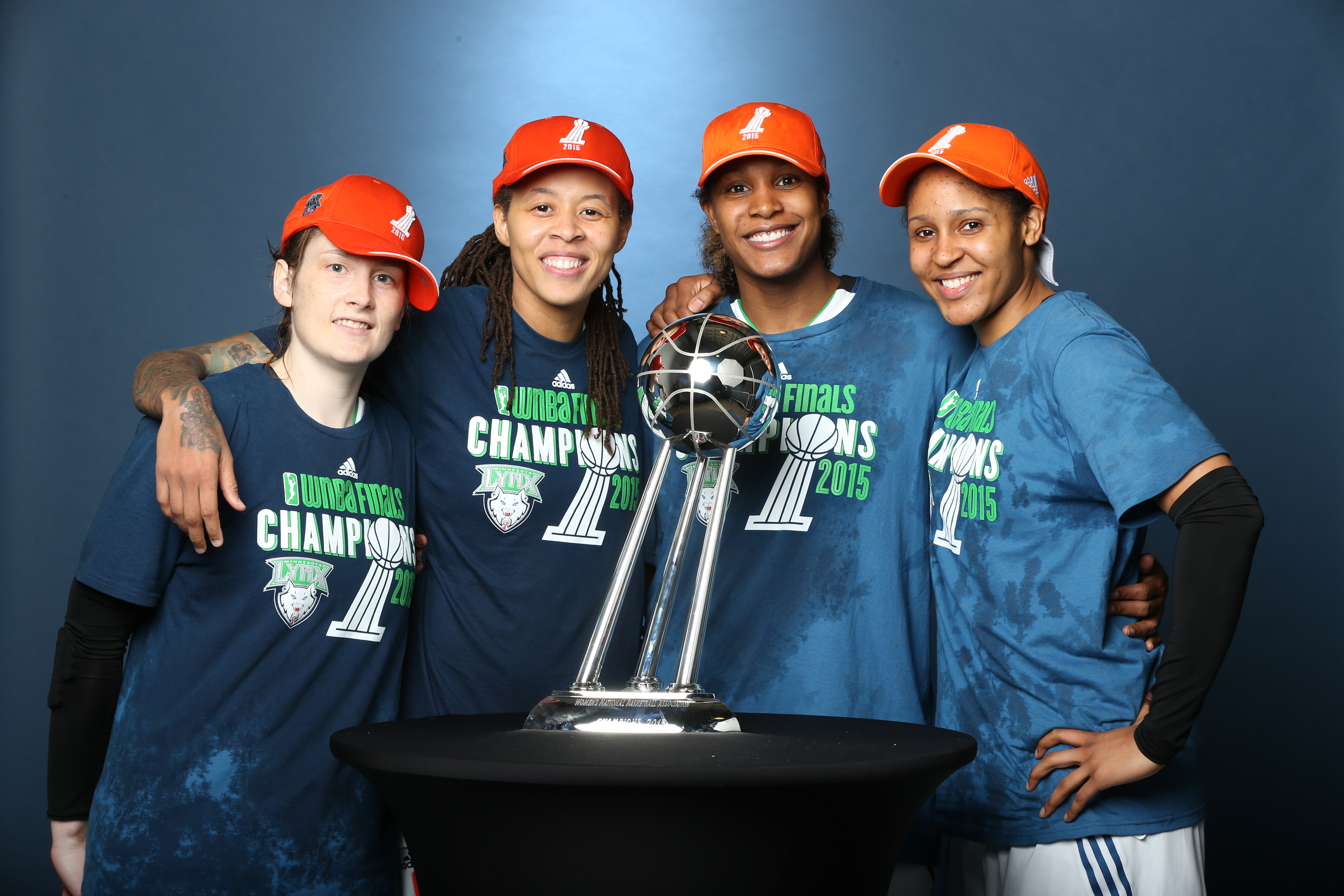 MINNEAPOLIS, MN - OCTOBER 14:  Lindsay Whalen #13, Seimone Augustus #33, Rebekkah Brunson #32 and Maya Moore #23 of the Minnesota Lynx pose for a portrait with the WNBA Championship Trophy after winning the 2015 WNBA Championship in Game Five of the 2015 WNBA Finals against the Indiana Fever on October 14, 2015 at Target Center in Minneapolis, Minnesota.  NOTE TO USER: User expressly acknowledges and agrees that, by downloading and or using this Photograph, user is consenting to the terms and conditions of the Getty Images License Agreement. Mandatory Copyright Notice: Copyright 2015 NBAE (Photo by David Sherman/NBAE via Getty Images)