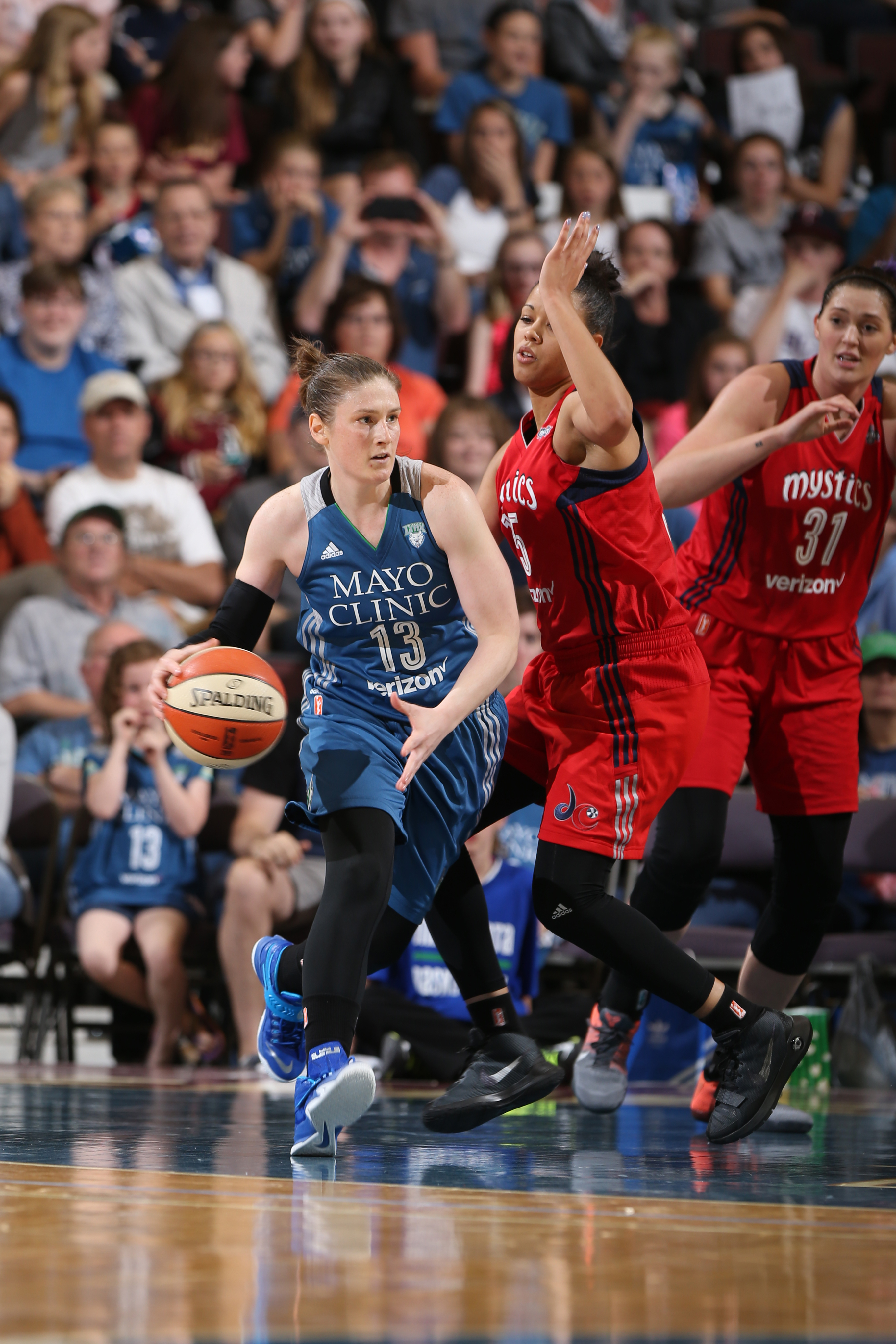 ROCHESTER, MN - MAY 8: Lindsay Whalen #13 of the Minnesota Lynx looks to pass against Natasha Cloud #15 of the Washington Mystics during the preseason game on May 8, 2016 at the Mayo Civic Center in Rochester, Minnesota. NOTE TO USER: User expressly acknowledges and agrees that, by downloading and or using this Photograph, user is consenting to the terms and conditions of the Getty Images License Agreement. Mandatory Copyright Notice: Copyright 2016 NBAE (Photo by David Sherman/NBAE via Getty Images)