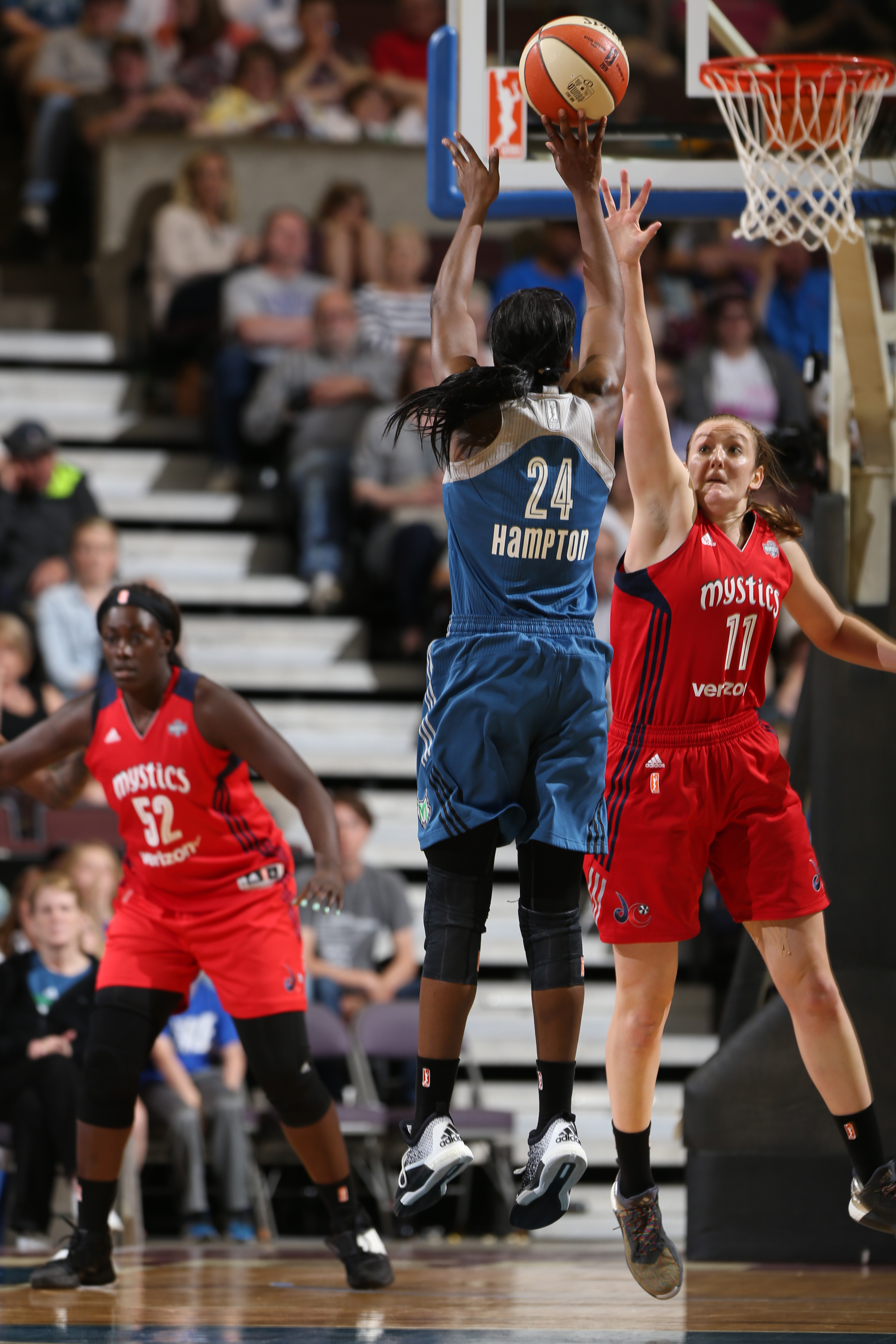 ROCHESTER, MN - MAY 8: Keisha Hampton #24 of the Minnesota Lynx shoots the basketball against Ally Malott #11 of the Washington Mystics during the preseason game on May 8, 2016 at the Mayo Civic Center in Rochester, Minnesota. NOTE TO USER: User expressly acknowledges and agrees that, by downloading and or using this Photograph, user is consenting to the terms and conditions of the Getty Images License Agreement. Mandatory Copyright Notice: Copyright 2016 NBAE (Photo by David Sherman/NBAE via Getty Images)