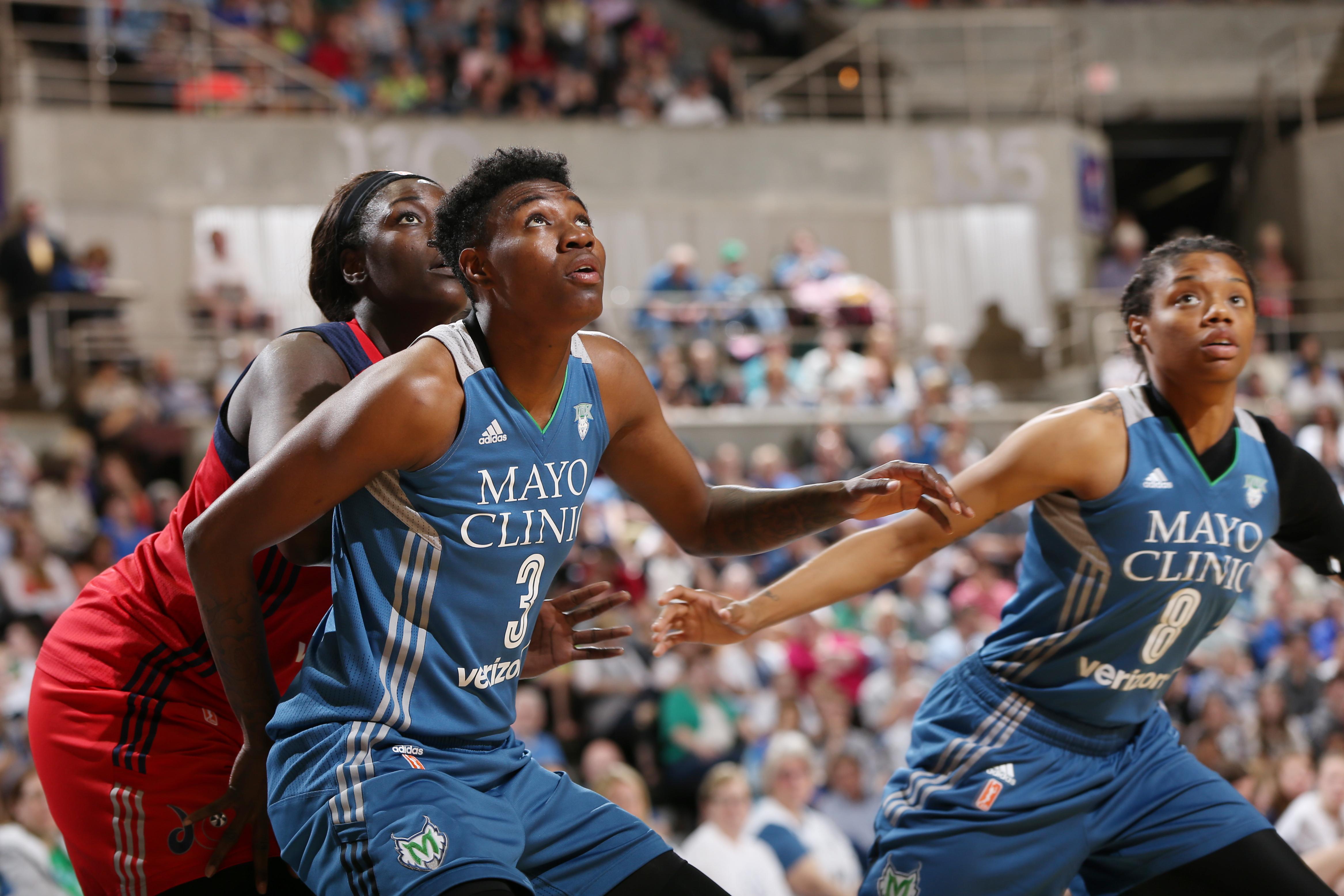ROCHESTER, MN - MAY 8: Natasha Howard #3 of the Minnesota Lynx looks to rebound the basketball against Chelsey Lee #52 of the Washington Mystics during the preseason game on May 8, 2016 at the Mayo Civic Center in Rochester, Minnesota. NOTE TO USER: User expressly acknowledges and agrees that, by downloading and or using this Photograph, user is consenting to the terms and conditions of the Getty Images License Agreement. Mandatory Copyright Notice: Copyright 2016 NBAE (Photo by David Sherman/NBAE via Getty Images)