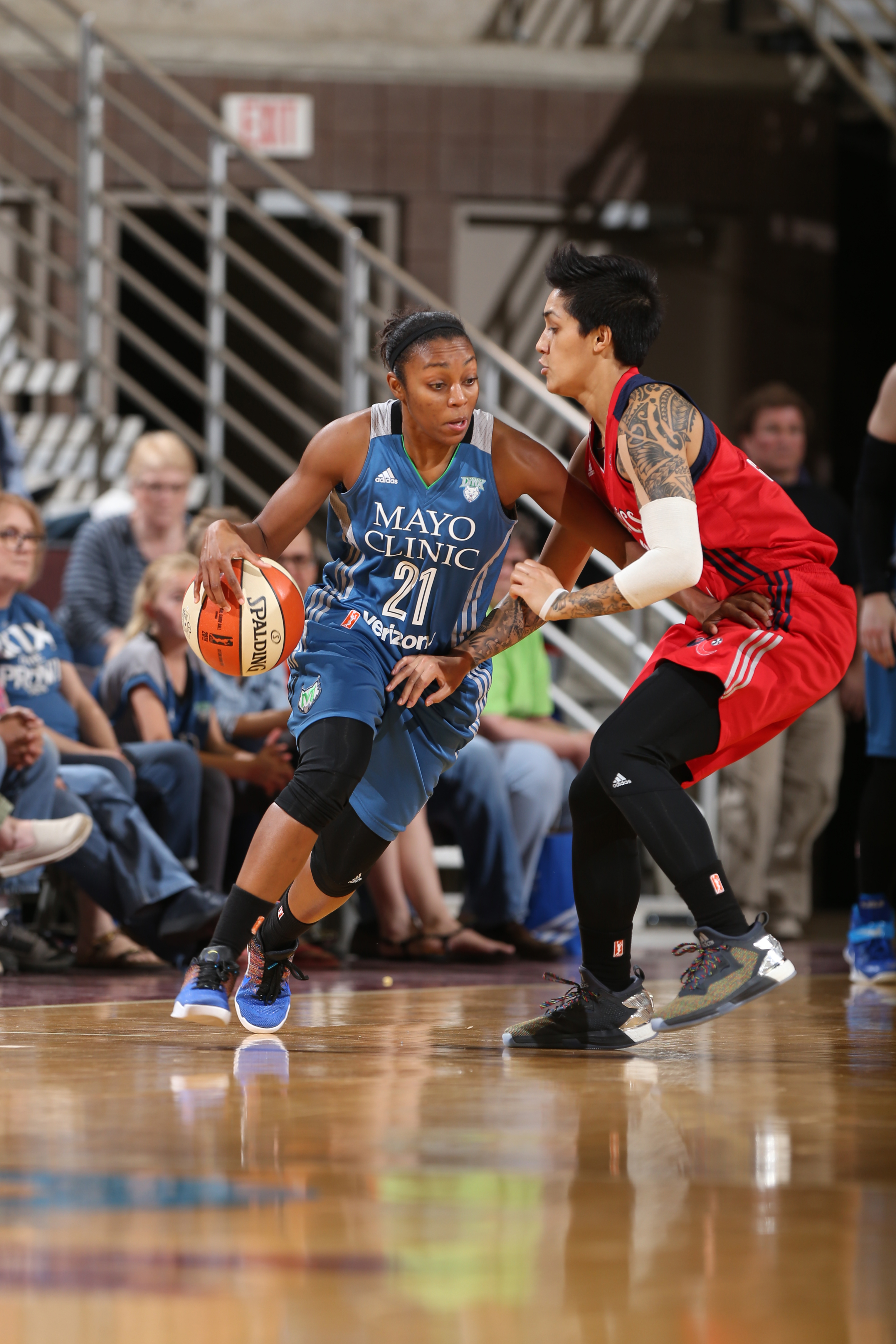 ROCHESTER, MN - MAY 8: Renee Montgomery #21 of the Minnesota Lynx drives against Lia Galdeira #3 of the Washington Mystics during the preseason game on May 8, 2016 at the Mayo Civic Center in Rochester, Minnesota. NOTE TO USER: User expressly acknowledges and agrees that, by downloading and or using this Photograph, user is consenting to the terms and conditions of the Getty Images License Agreement. Mandatory Copyright Notice: Copyright 2016 NBAE (Photo by David Sherman/NBAE via Getty Images)