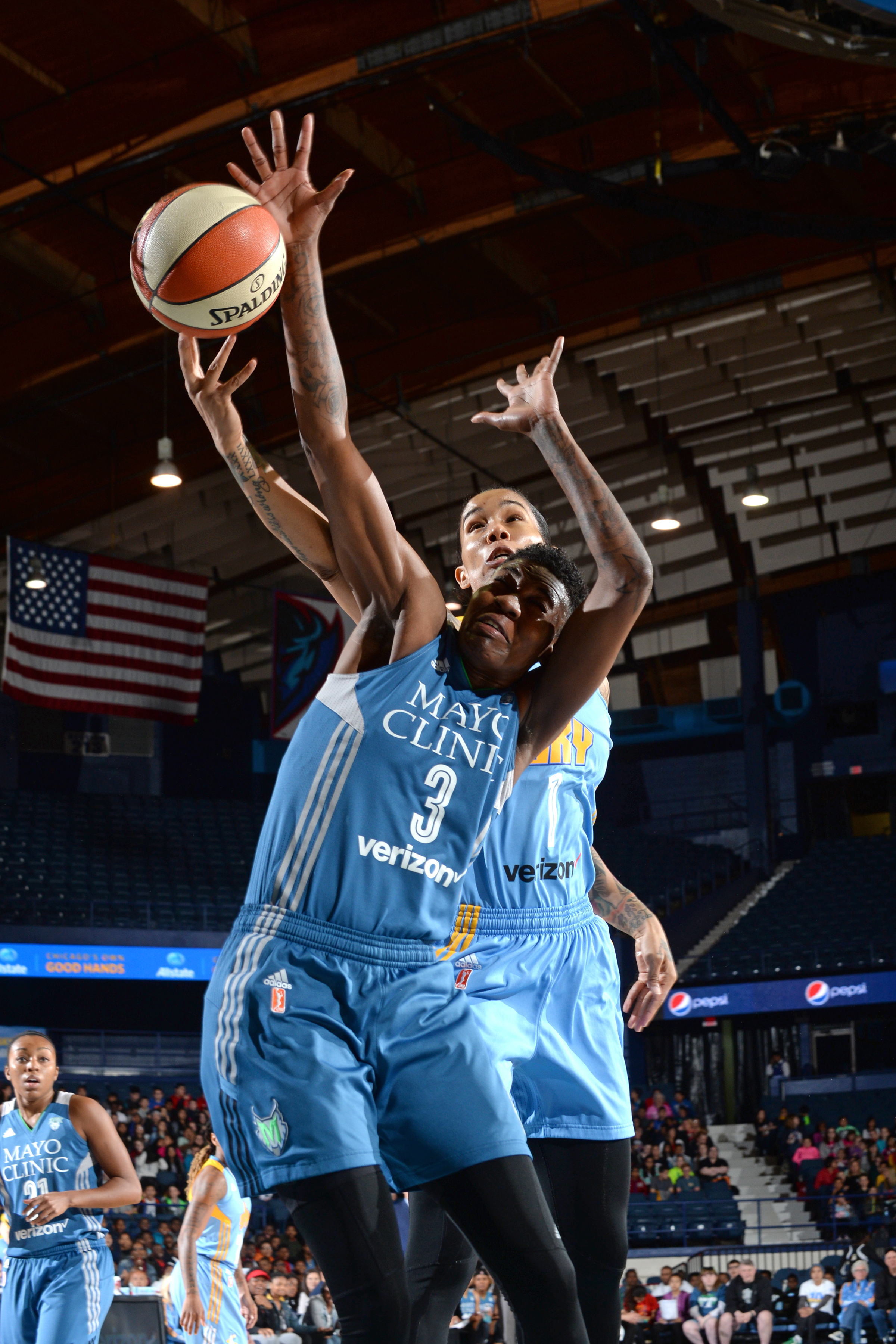 ROSEMONT, IL- MAY 18: Tamera Young #1 of the Chicago Sky drives to the basket against Natasha Howard #3 of the Minnesota Lynx on May 18, 2016 at the Allstate Arena in Rosemont, Illinois. NOTE TO USER: User expressly acknowledges and agrees that, by downloading and/or using this photograph, user is consenting to the terms and conditions of the Getty Images License Agreement. Mandatory Copyright Notice: Copyright 2016 NBAE (Photo by Randy Belice/NBAE via Getty Images)