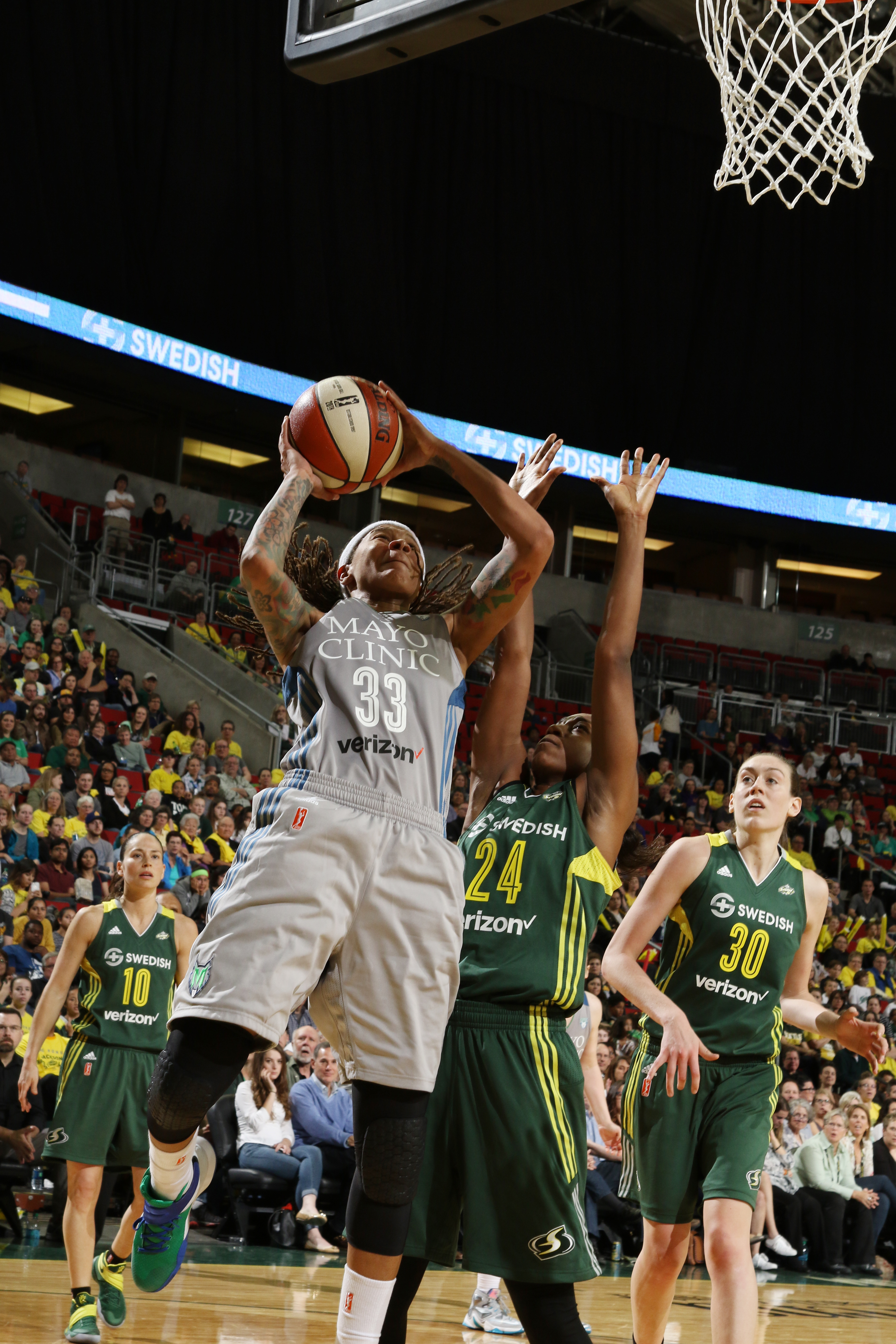 SEATTLE, WA - MAY 22:  Seimone Augustus #33 of the Minnesota Lynx shoots the ball against the Seattle Storm on May 22, 2016 at KeyArena in Seattle, Washington. NOTE TO USER: User expressly acknowledges and agrees that, by downloading and or using this photograph, user is consenting to the terms and conditions of Getty Images License Agreement. Mandatory Copyright Notice: Copyright 2016 NBAE (Photo by Josh Huston/NBAE via Getty Images)