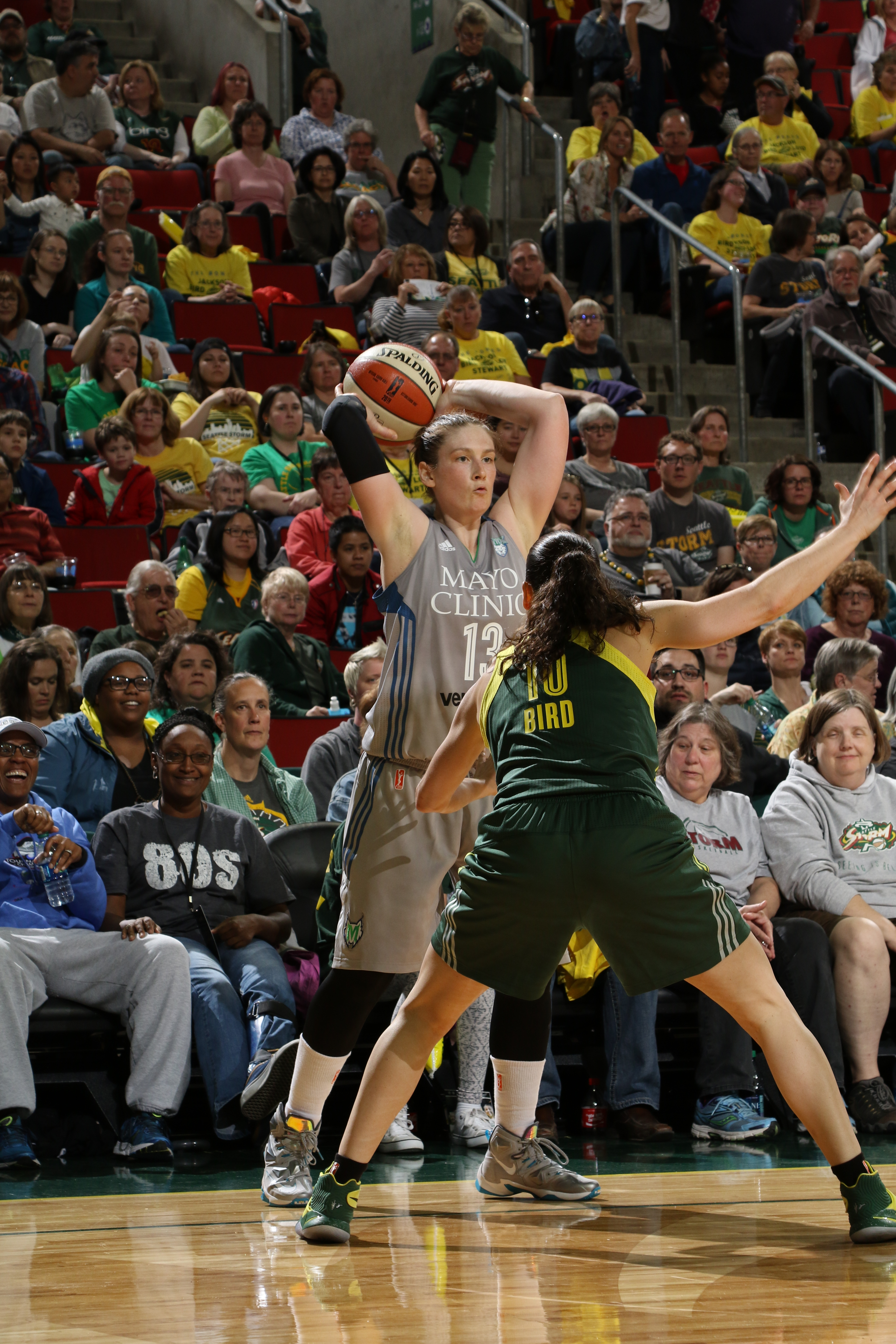 SEATTLE, WA - MAY 22:  Lindsay Whalen #13 of the Minnesota Lynx handles the ball against the Seattle Storm on May 22, 2016 at KeyArena in Seattle, Washington. NOTE TO USER: User expressly acknowledges and agrees that, by downloading and or using this photograph, user is consenting to the terms and conditions of Getty Images License Agreement. Mandatory Copyright Notice: Copyright 2016 NBAE (Photo by Josh Huston/NBAE via Getty Images)
