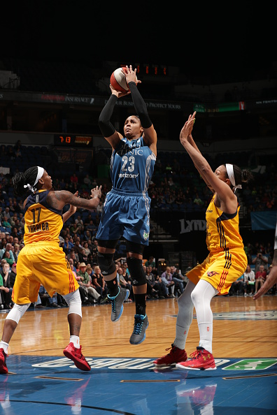 MINNEAPOLIS, MN - MAY 27:  Maya Moore #23 of the Minnesota Lynx shoots against Erica Wheeler #17 of the Indiana Fever on May 27, 2016 at Target Center in Minneapolis, Minnesota. NOTE TO USER: User expressly acknowledges and agrees that, by downloading and or using this Photograph, user is consenting to the terms and conditions of the Getty Images License Agreement. Mandatory Copyright Notice: Copyright 2016 NBAE (Photo by Jordan Johnson/NBAE via Getty Images)