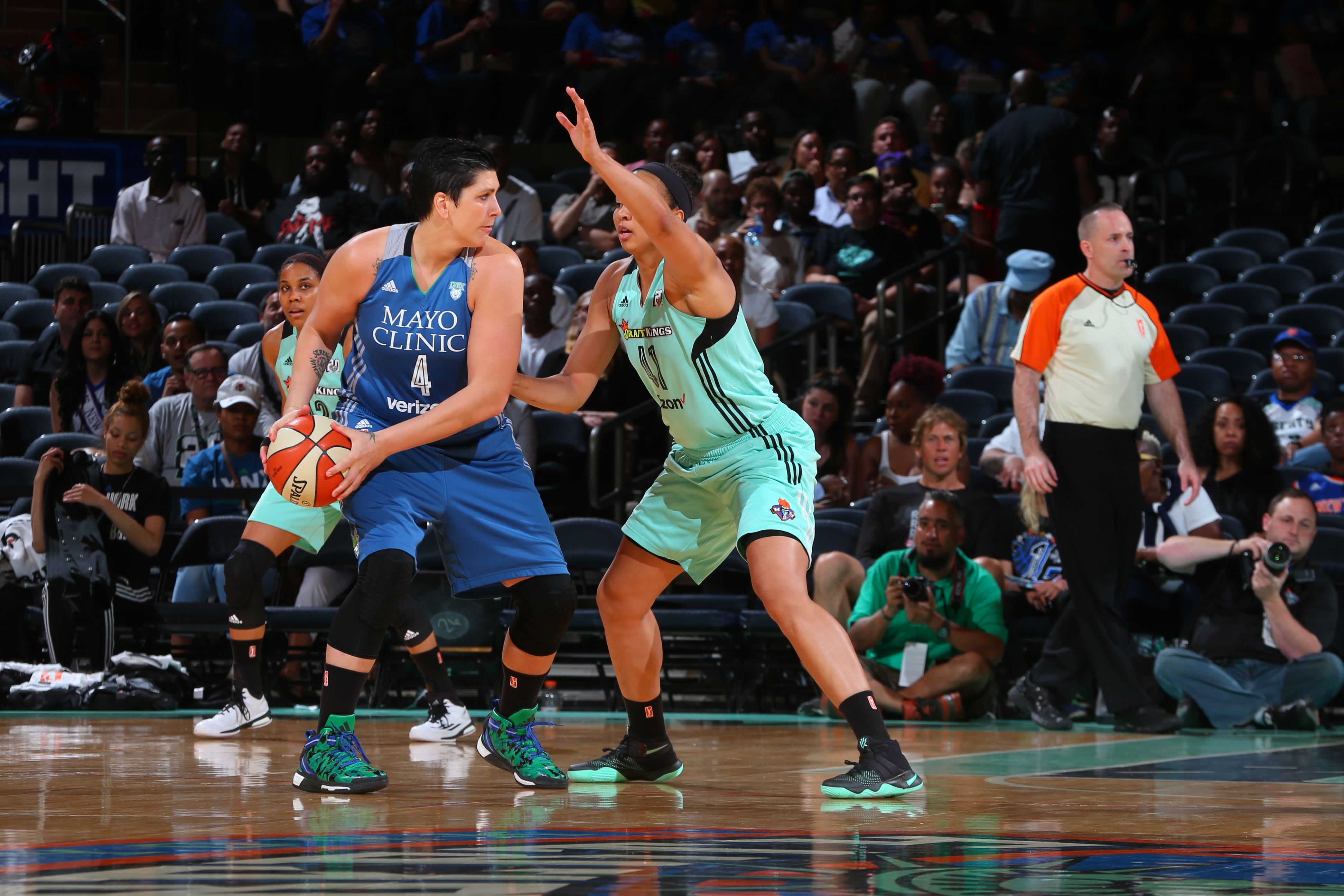 NEW YORK, NY - MAY 31: Janel McCarville #4 of the Minnesota Lynx defends the ball against Kiah Stokes #41 of the New York Liberty during the game on May 31, 2016 at Madison Square Garden in New York, New York. NOTE TO USER: User expressly acknowledges and agrees that, by downloading and or using this Photograph, user is consenting to the terms and conditions of the Getty Images License Agreement. Mandatory Copyright Notice: Copyright 2016 NBAE (Photo by Mike Stobe/NBAE via Getty Images)