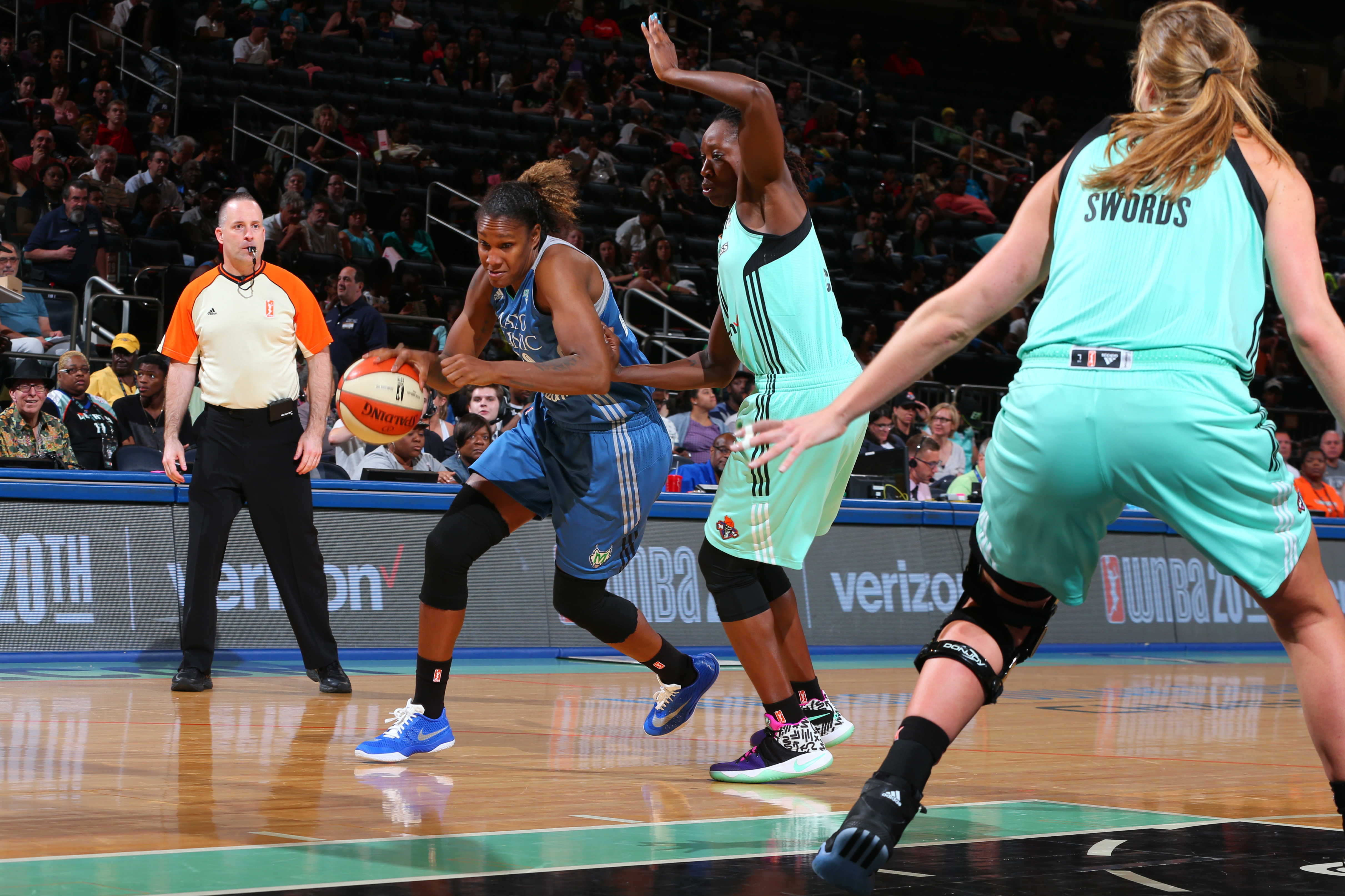 NEW YORK, NY - MAY 31: Rebekkah Brunson #32 of the Minnesota Lynx drives to the basket against the New York Liberty during the game on May 31, 2016 at Madison Square Garden in New York, New York. NOTE TO USER: User expressly acknowledges and agrees that, by downloading and or using this Photograph, user is consenting to the terms and conditions of the Getty Images License Agreement. Mandatory Copyright Notice: Copyright 2016 NBAE (Photo by Mike Stobe/NBAE via Getty Images)