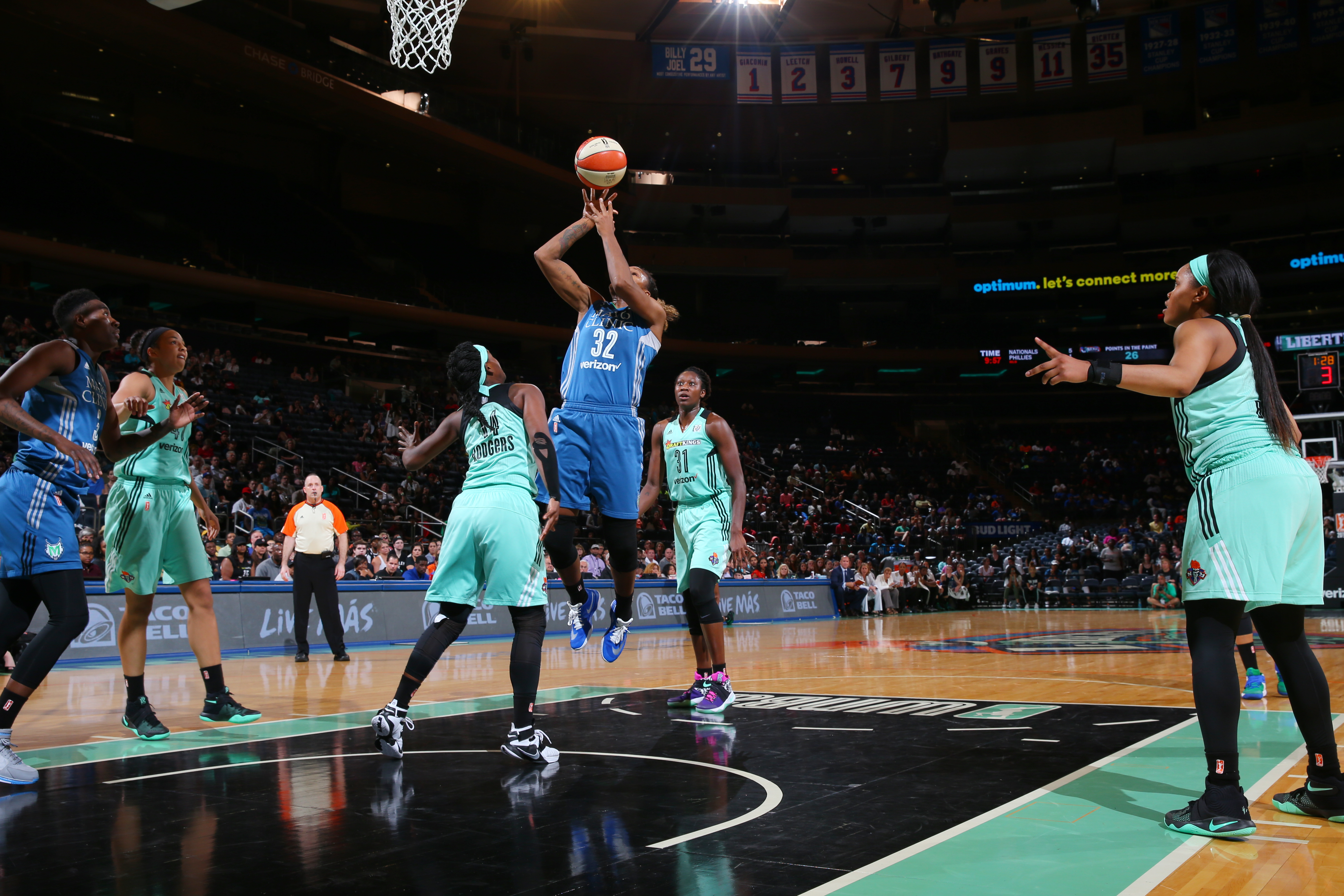 NEW YORK, NY - MAY 31: Rebekkah Brunson #32 of the Minnesota Lynx shoots against the New York Liberty during the game on May 31, 2016 at Madison Square Garden in New York, New York. NOTE TO USER: User expressly acknowledges and agrees that, by downloading and or using this Photograph, user is consenting to the terms and conditions of the Getty Images License Agreement. Mandatory Copyright Notice: Copyright 2016 NBAE (Photo by Mike Stobe/NBAE via Getty Images)