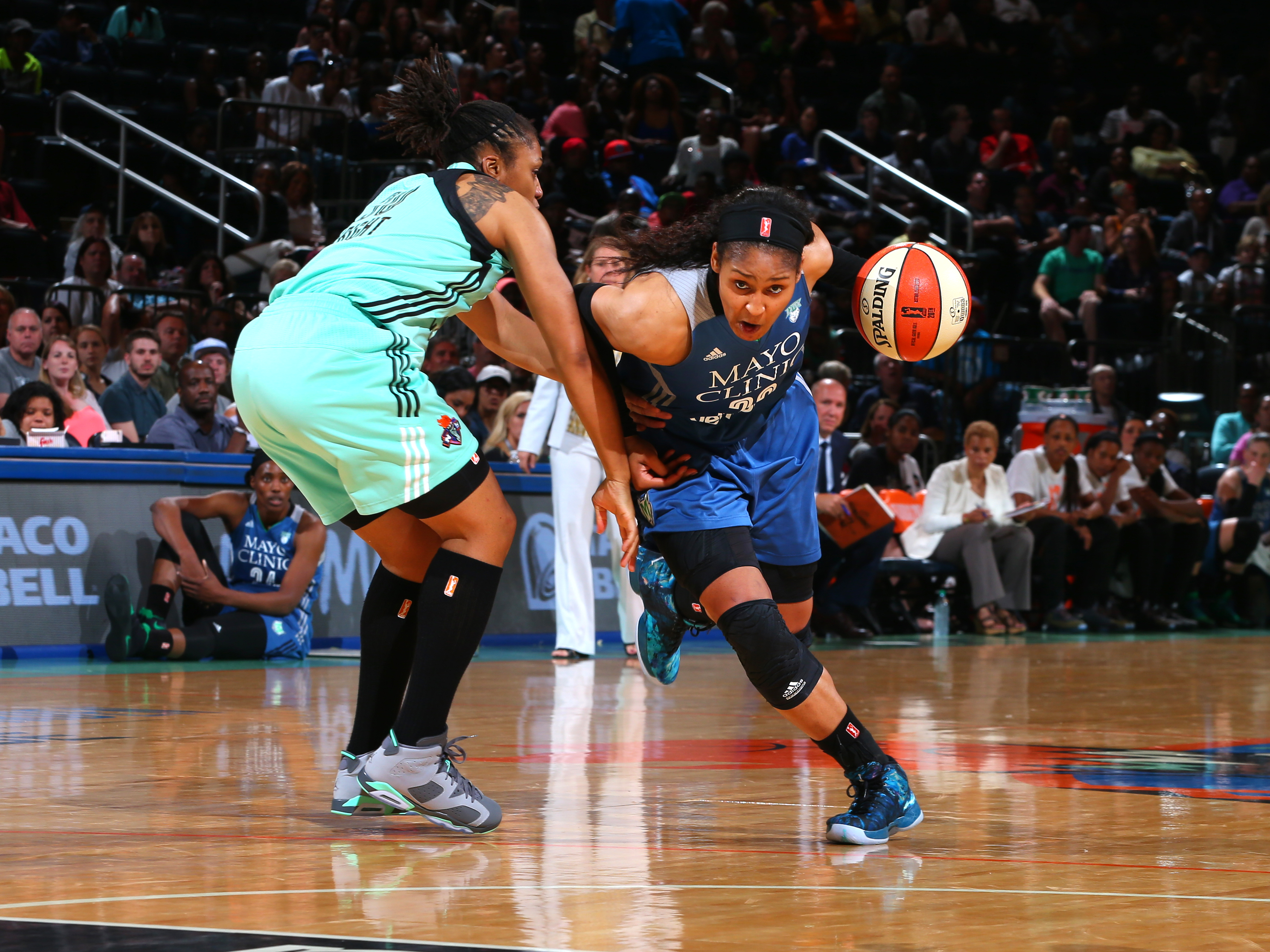 NEW YORK, NY - MAY 31:  Maya Moore #23 of the Minnesota Lynx handles the ball against the New York Liberty during the game on May 31, 2016 at Madison Square Garden in New York, New York. NOTE TO USER: User expressly acknowledges and agrees that, by downloading and or using this Photograph, user is consenting to the terms and conditions of the Getty Images License Agreement. Mandatory Copyright Notice: Copyright 2016 NBAE (Photo by Mike Stobe/NBAE via Getty Images)